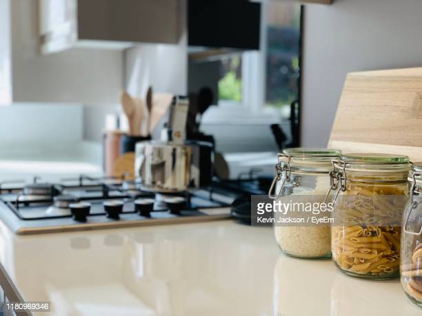 food in jars on kitchen counter - kitchen counter stock pictures, royalty-free photos & images