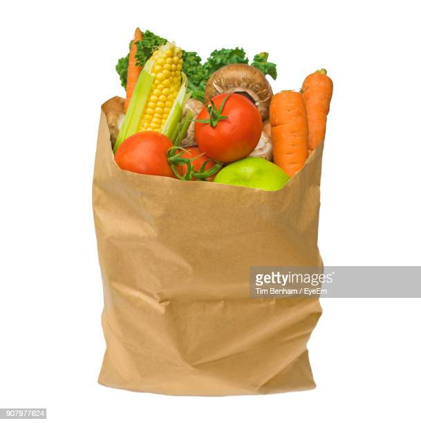 Food In Paper Bag Against White Background