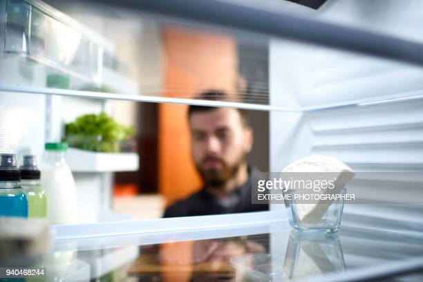 food in the refrigerator - help:contents stock pictures, royalty-free photos & images