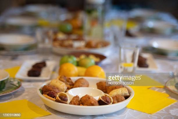 Food is laid out on the table of the Martin family in Newfields, for Iftar, the evening meal that will end their daily fast at sunset, on the first...