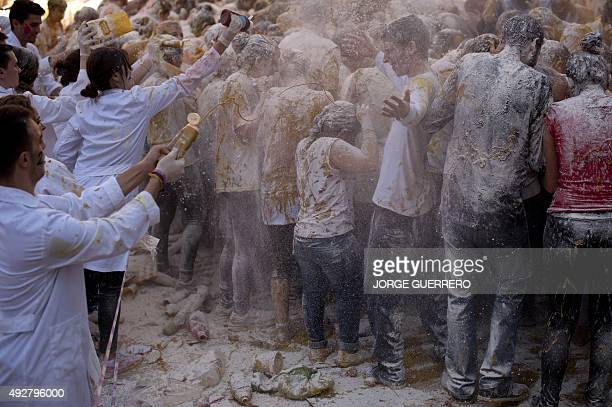 Food is poured on freshman year medical students already covered with food stuffs during the faculty of medicine hazing at the University of Granada...