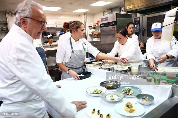 Food is prepared during the Alain Ducasse celebration of women in the kitchen part of the Bank of America Dinner Series presented by The Wall Street...