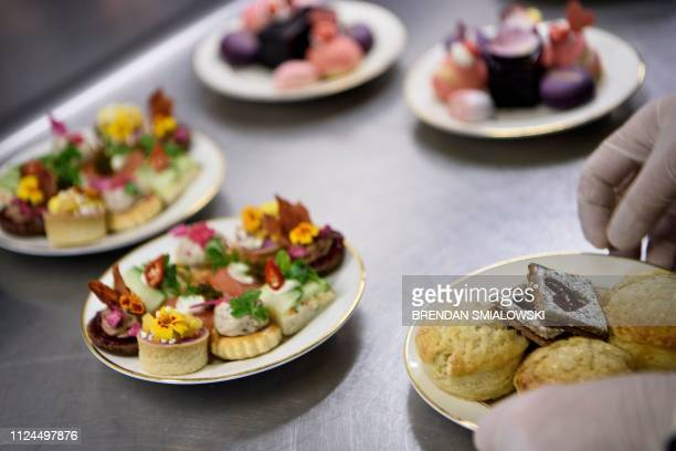 Food is prepared for Galentine's Day tea at the St Regis hotel on February 12 2019 in Washington DC For some people facing the onslaught of...