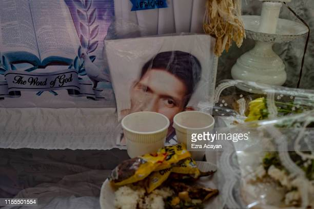 Food is seen on the coffin of John Ryan Marquez on July 13 2019 in Malabon Metro Manila Philippines According to police Marquez was killed in a...