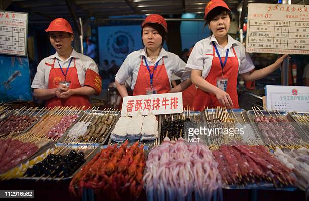 Food is sold at Beijing's famous Donghuamen Night market where one can sample many different specialty foods found throughout China June 14 2008 A...