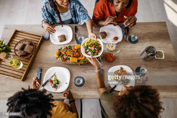 food is the best excuse to get together - vegetarianism stock pictures, royalty-free photos & images