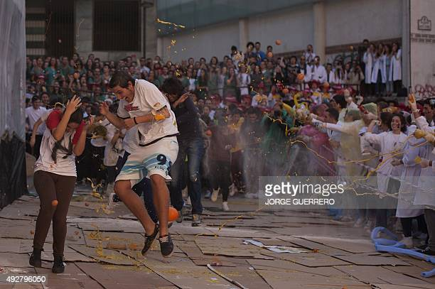 Food is thrown at freshman year medical students during the faculty of medicine hazing at the University of Granada in Granada on October 15 2015 AFP...