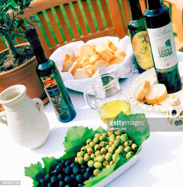 Food Italian food olive oil black olives green olives white bread typical Italian white bread