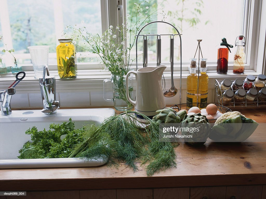 Kitchen sink area kitchen design ideas food items and ings at kitchen sink area stock photo getty workwithnaturefo