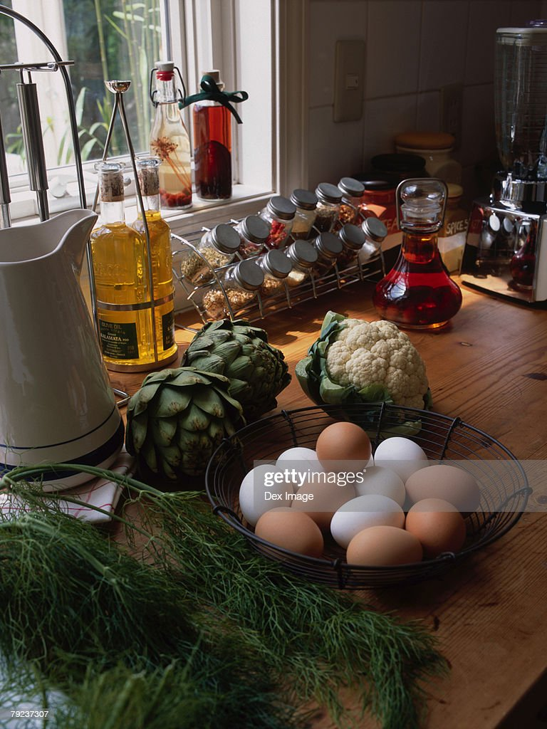 Food items and ingredients on kitchen table : Stock Photo