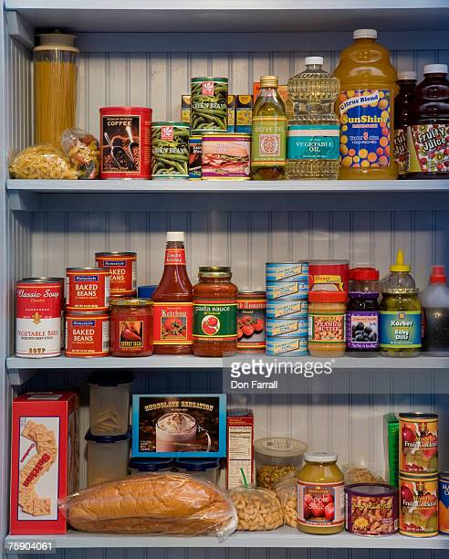 food items on pantry shelves - storage compartment stock pictures, royalty-free photos & images