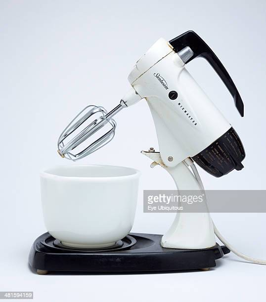 Food Kitchen Equipment Sunbeam Mixmaster electric food blender or mixer circa 1953 on a white background