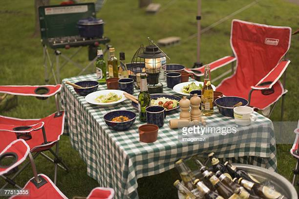 Food laid out on a Table on Campsite