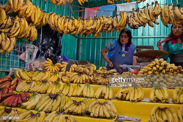 Food market and traders selling their wares and goods on display bananas San Cristobal de las Casas Chiapas Mexico