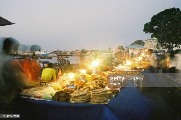food market dusk scene stonetown - zanzibar stock photos and pictures