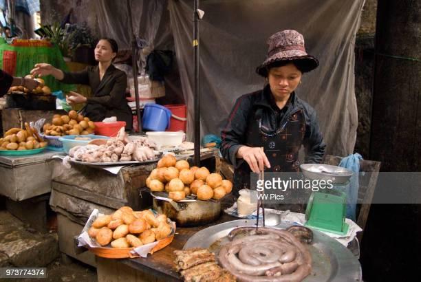 Food market stand serving food Sapa region North Vietnam Asia Ethnic Hmong tribe shopping at Muong Hum market Vietnam