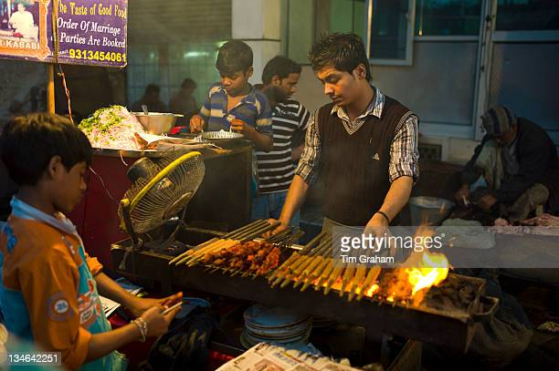 Food meat kebabs on sale at meat stall in Snack market at muslim Meena Bazar in Old Delhi India
