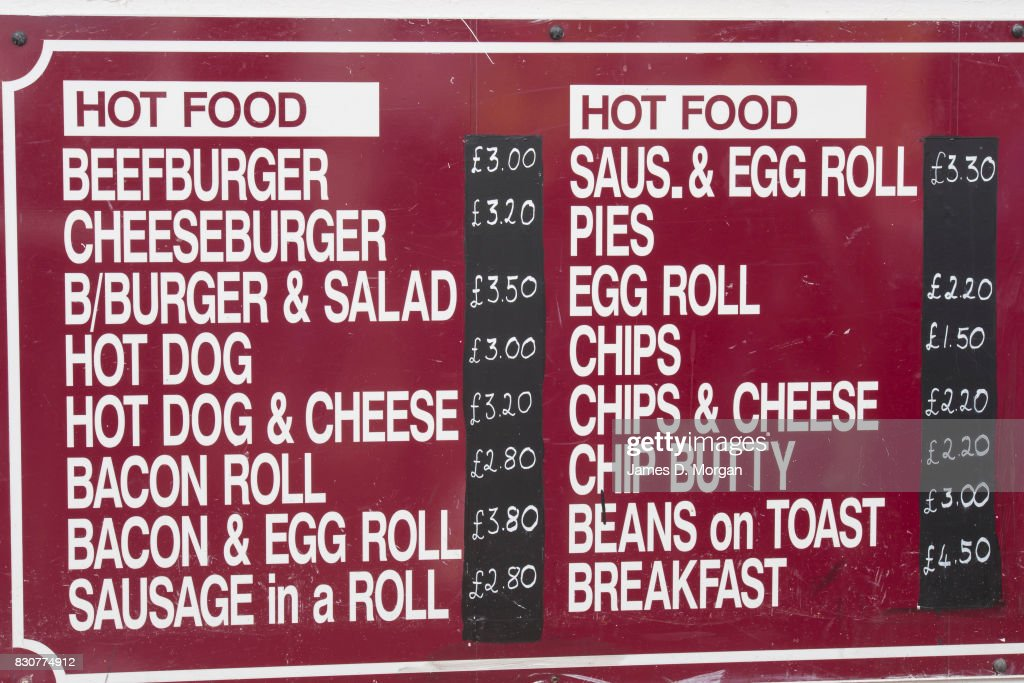 A food menu at a kiosk on August 12, 2017 in Great Yarmouth, England. A cloudy overcast day greeted visitors to the Norfolk seaside town on one of the busiest weekends of the summer period. The town has been a seasiside resort since 1760 and today it has developed renewable energy sources with a wind farm of 30 generators within sight of the town in the North Sea. Thousands of British holidaymakers will visit the area over the summer period.