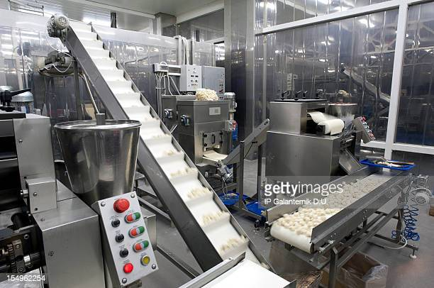 Food moving through production line in factory