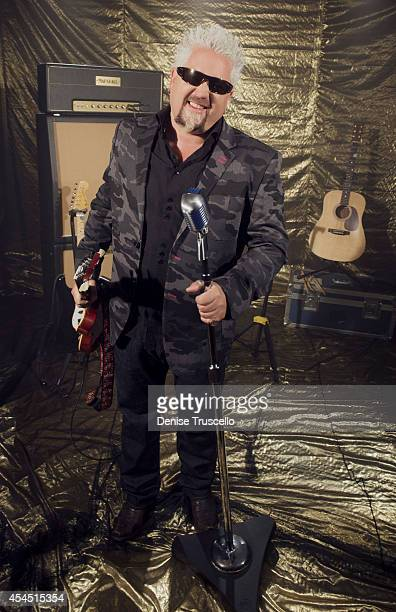 Food network personality Guy Fieri poses for a portrait at the Academy of Country Music Awards for People Magazine on April 6 2014 in Las Vegas Nevada