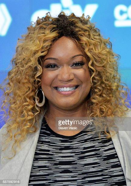 Food Network personality Sunny Anderson rings the NASDAQ Opening Bell at NASDAQ on June 2 2016 in New York City