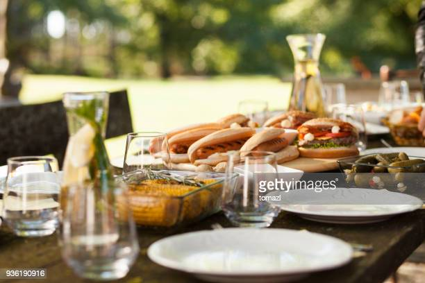 food on a picnic table - outdoor party stock pictures, royalty-free photos & images