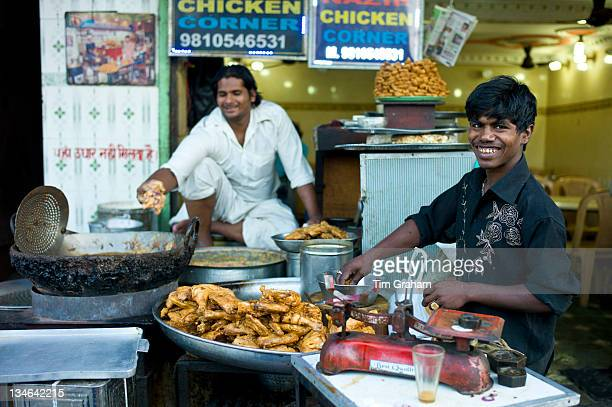 Food on sale at Chicken Corner in Snack market at muslim Meena Bazar in Old Delhi India