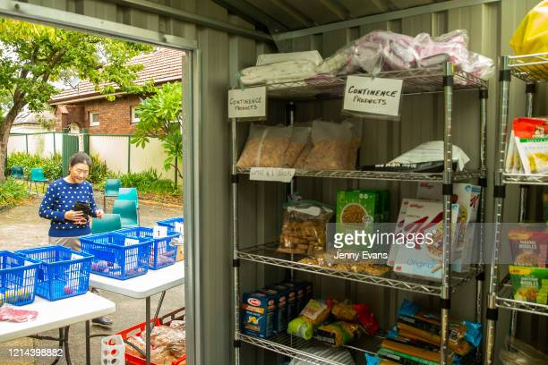Food on shelves is seen at St Paul's Anglican Church in Burwood on March 24 2020 in Sydney Australia The Parish Pantry provides food for the...