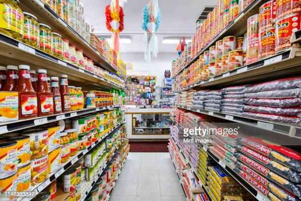food on shelves of grocery store - aisle stock pictures, royalty-free photos & images