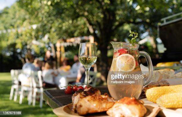 food on table set outdoors for celebrating birthday, garden party concept. - garden party stock pictures, royalty-free photos & images