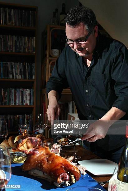 Food photographer Rob Fiocca carves the pig's head Corey Mintz hosts food stylist Christopher St Onge food photographer Rob Fiocca writer Paul...