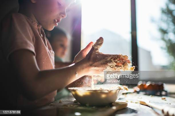 food preparation at home - sister stock pictures, royalty-free photos & images