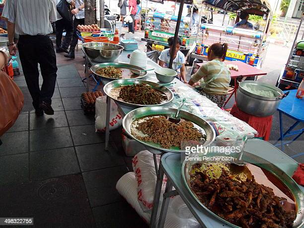 Food prepared and ready to eat along the sidewalk in Bangkok, Thailand.