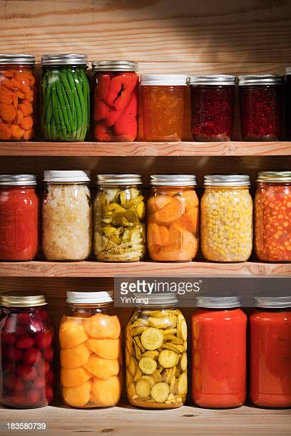food preserves canning jars on shelves, fruit and vegetable storage - pickled stock pictures, royalty-free photos & images