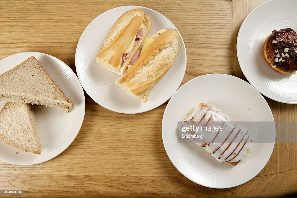 Food products from Greggs Plc's, left to right, Tuna Mayonnaise and Cucumber sandwich, Ham and Cheese baguette, Apple Danish and a Triple Chocolate Doughnut sit on a counter during a Greggs Plc taste test in London, U.K., on Wednesday, Oct. 28, 2015. Same-store sales at Greggs have grown 5.6 percent so far in 2015, up from 3.9 percent across the same period last year, and the company said on Oct. 6 that full-year growth will exceed its previous forecast slightly. Photographer: Matthew Lloyd/Bloomberg via Getty Images
