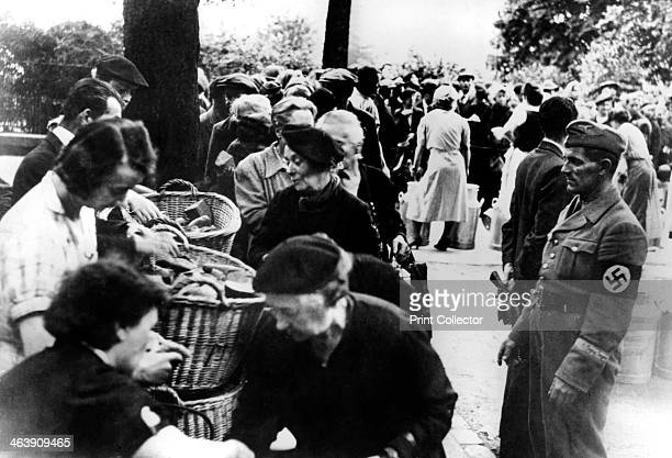 Food relief for refugees returned to Paris after the German capture of the city 1940 Some 16 million people who had fled Paris before the arrival of...