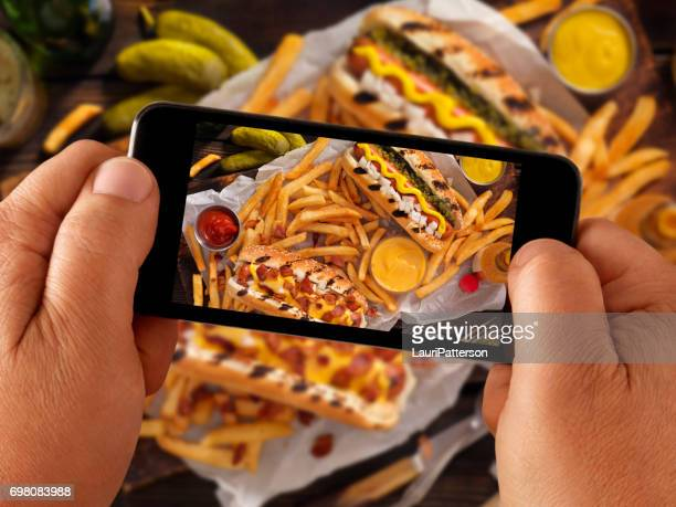 Food Selfie of BBq Hotdogs and Fries