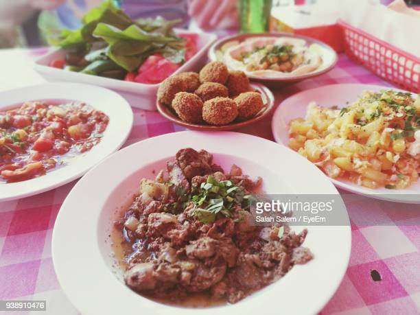 food served in plates on table - salah stock photos and pictures