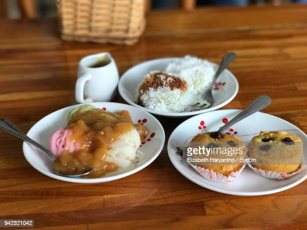 food served in plates on table - makassar stock pictures, royalty-free photos & images