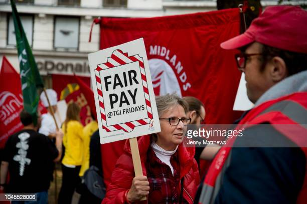 Food service industry workers strike for higher wages on October 4th 2018 in Leicester Square London United Kingdom Day of action by workers from TGI...