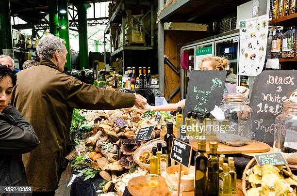 food shop at borough market london - borough market stock pictures, royalty-free photos & images