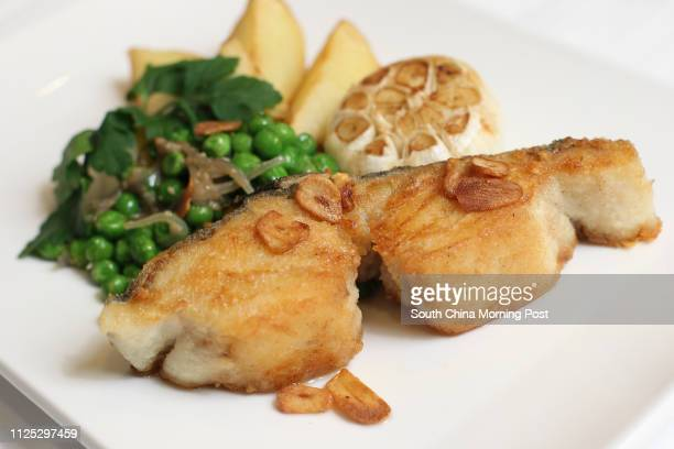 Food shot of Grilled salted cod fish at Nino's Cozinha QRE Plaza in Wan Chai 29FEB12