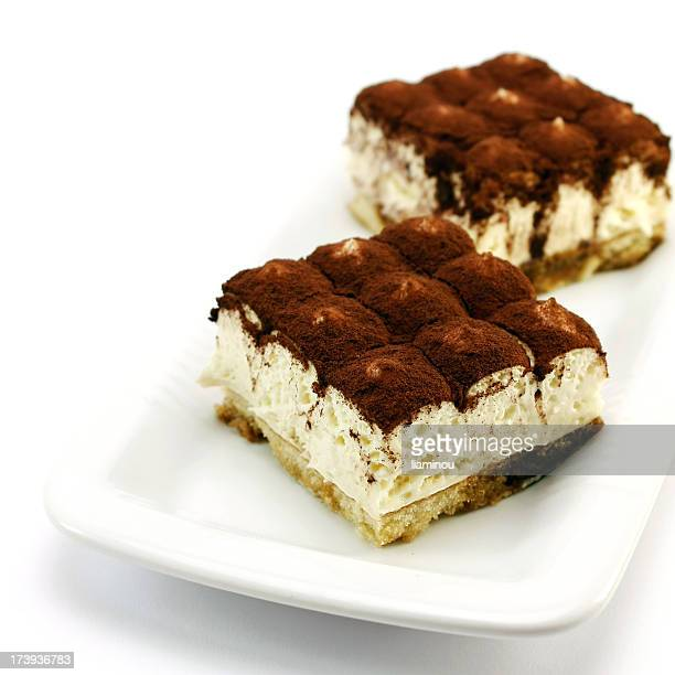 Food shot of two tiramisu cakes on a plate