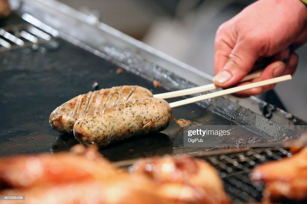 Food stall cooking sausage at Omotesando on New Year's Eve : Stock Photo