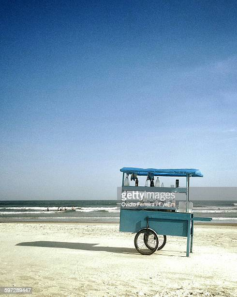 Food Stall On Beach Against Blue Sky