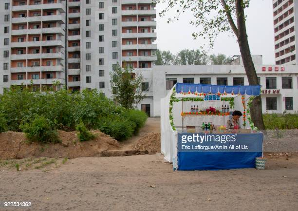 Food stall with no customers in front of apartment blocks Pyongan Province Pyongyang North Korea on September 9 2011 in Pyongyang North Korea