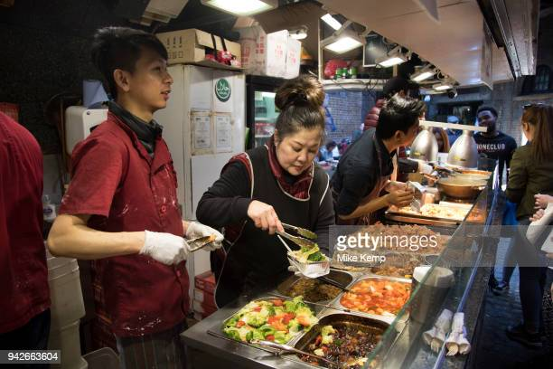 Food stalls selling street food at the busy hang out for young Londoners and tourists in Camden Town, London, England, United Kingdom. Camden Town is...