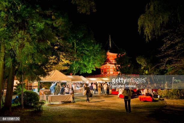 Food stalls set up in front of the Pagoda at Daikakuji temple
