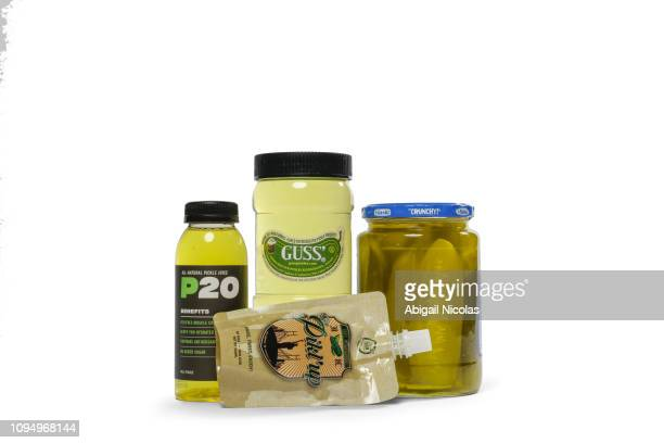 Still life portrait of various pickle products during photo shoot at Meredith Studios Athletes have increasingly been using pickle juices and brines...
