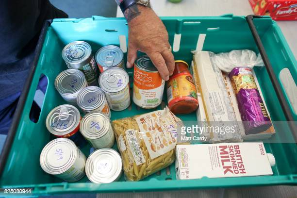 Food stocks from the charity Transformation CPR are seen at the foodbank being run at the Camborne Centenary Methodist Church in Camborne on July 25...